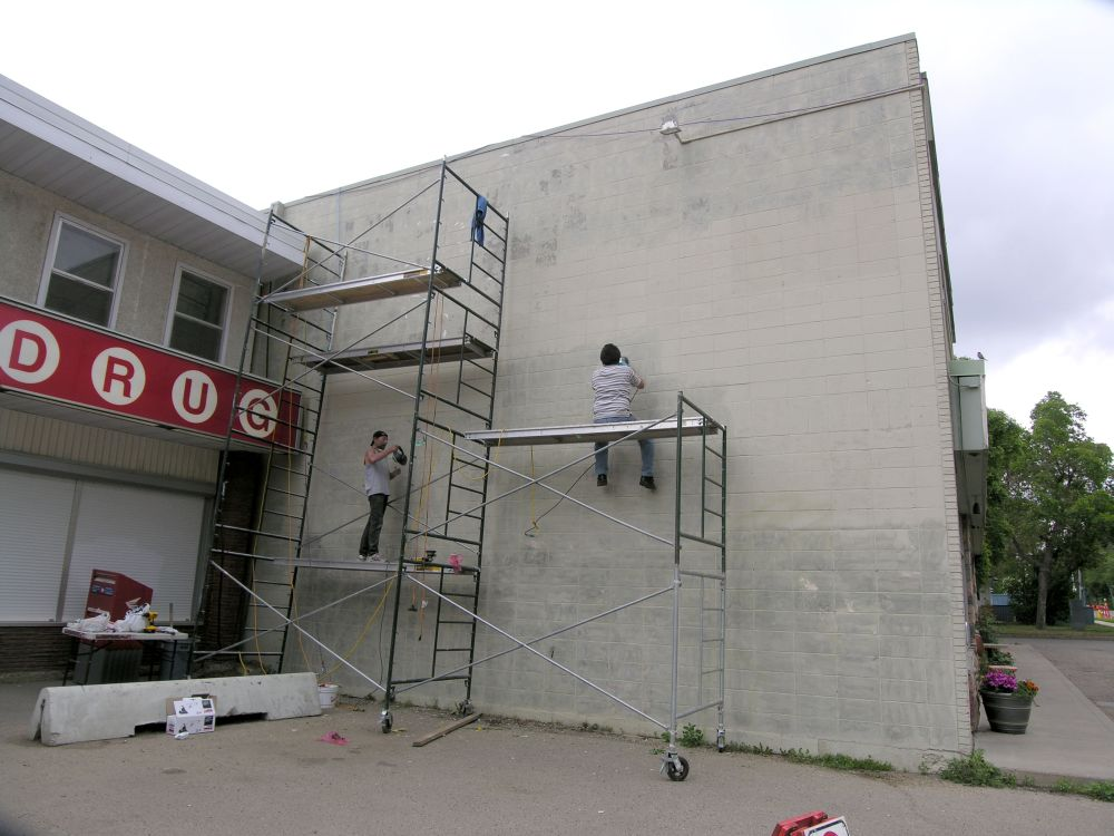 Wall scraping for James K-M's Stathearn mural in Edmonton