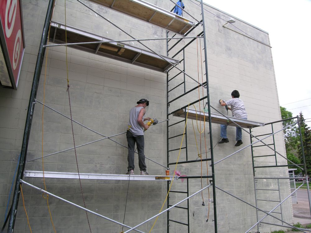 Strathearn Mural wall preparation: Scraping
