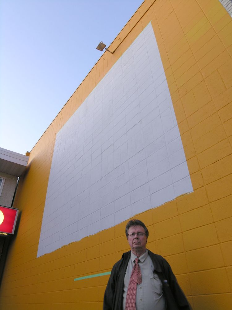 Photographer Ron Snider in front of the Yellow Wall